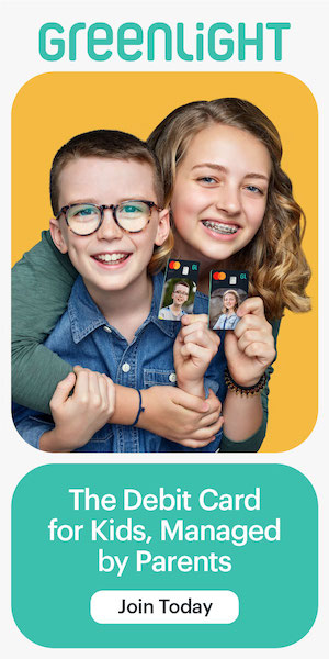a young boy and girl posing with their greenlight debit cards